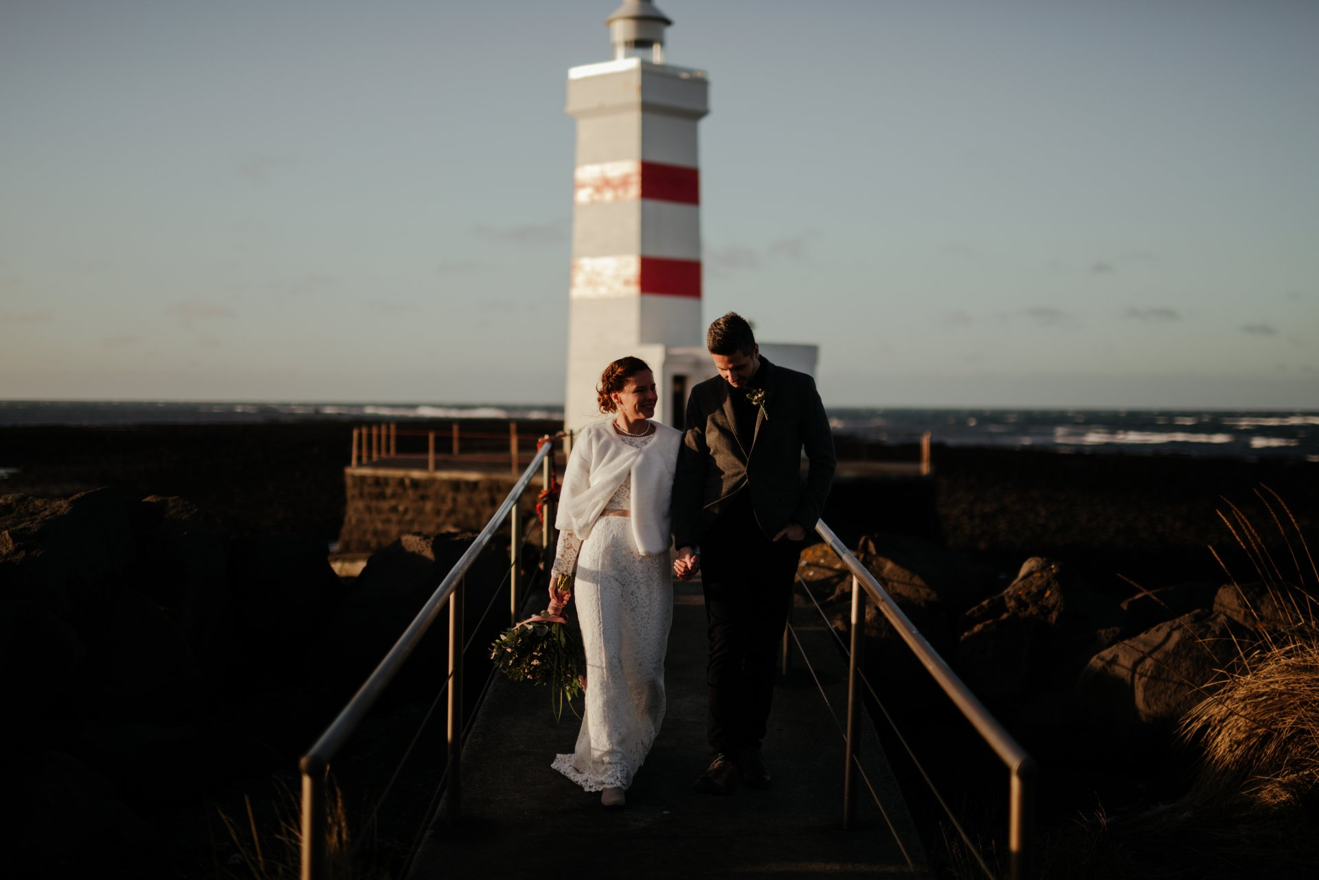 The wedding was held at the toe of Reykjanes peninsula, at Garðskagaviti (lighthouse of Garður) on a cold but beautiful February day. Photographer: Renáta Török-Bognár